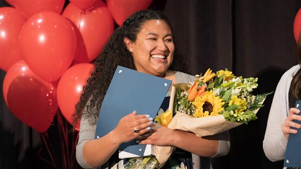 Kinsey teacher Jordan Morales smiles after being awarded Coconino County Teacher of the Year.