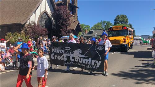 Coconino Panthers cross country walk with FUSD in the 4th of July Parade