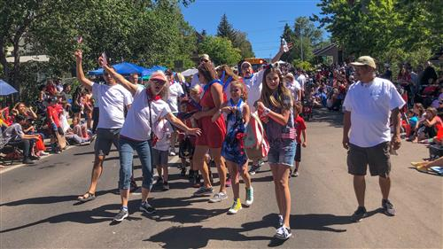 Staff and families of FUSD pose together in the 4th of July parade