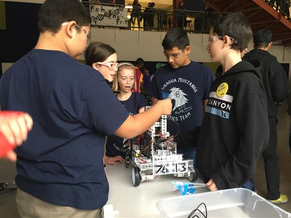 Sinagua students work on a robot at a competition hosted in Phoenix, Arizona.