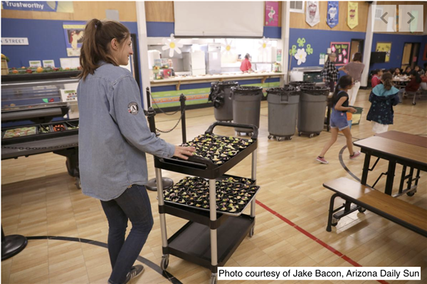 Brooke Kahl, a FoodCorps service member with food in cafeteria. Courtesy Jake Bacon, AZ Daily Sun