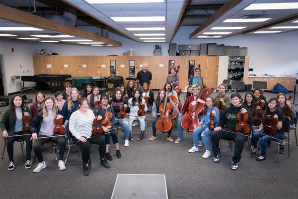 Members of the CHS Orchestra pose with their instruments.