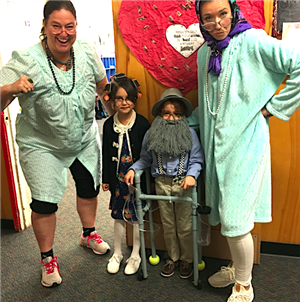 2 first grade teachers and 2 students dressed as if they were 100 years old