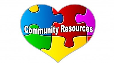 puzzle piece heart with the words community resources written on it