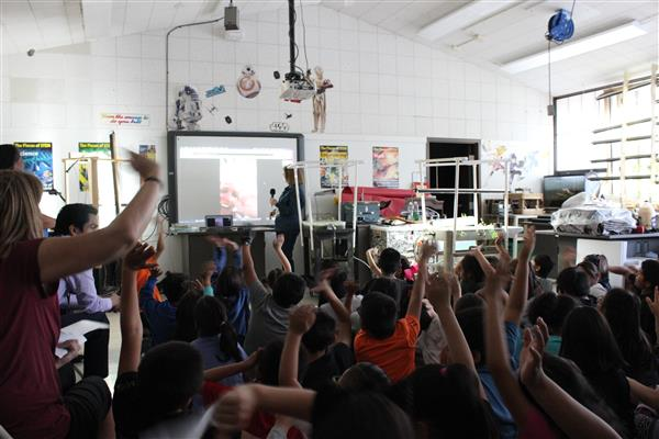Students waving to the teacher in North Carolina as they begin the Google Hangout