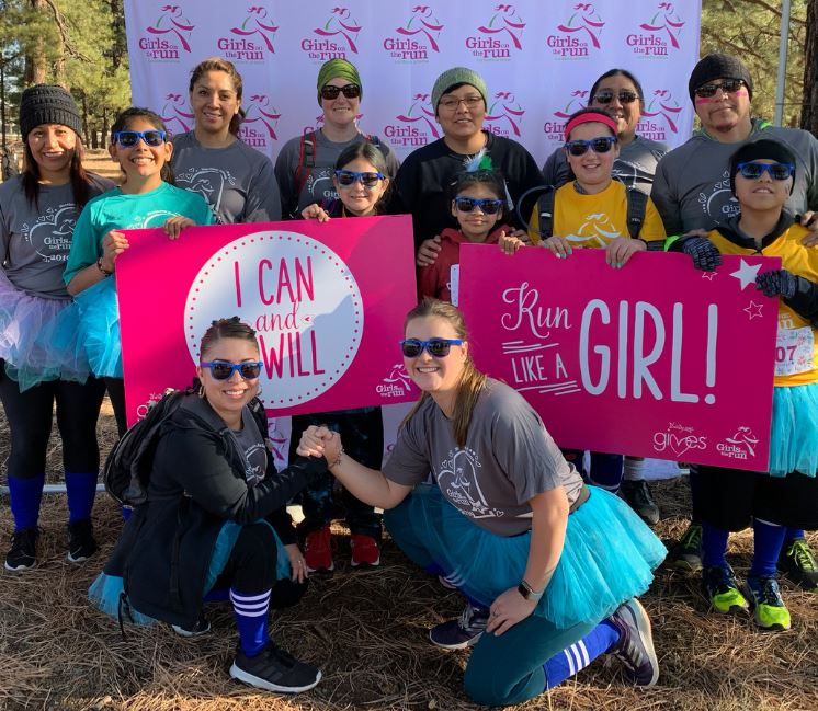 Killlip's Girls on the Run Students, Family Members, and Coaches posing at the event on November 9