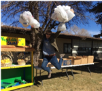 AmeriCorps Member jumping with excitement about giving families the food they need