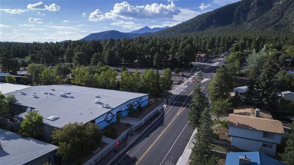 Aerial shot of Mount Elden Middle School with mountains in background.